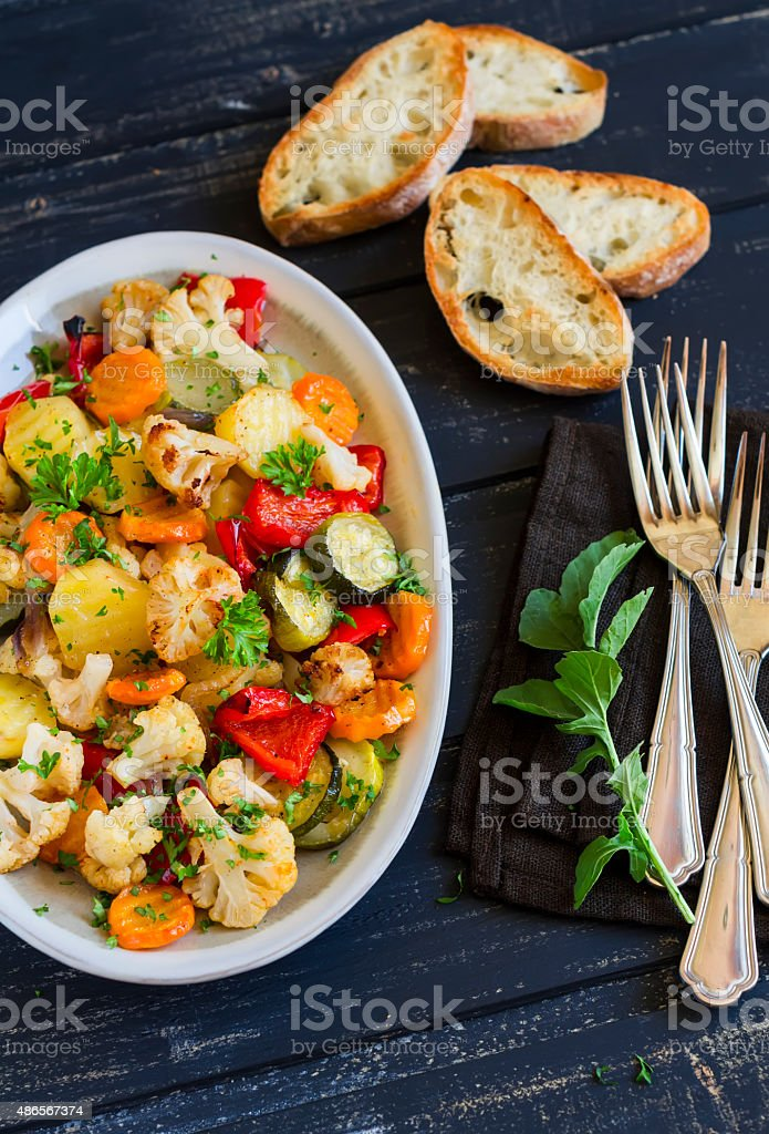 roasted vegetables - zucchini, cauliflower, potatoes, carrots, onions, peppers stock photo