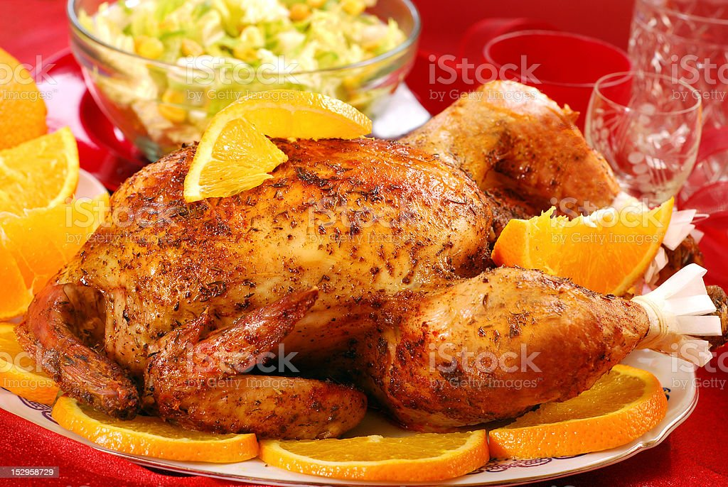 roasted whole chicken with oranges royalty-free stock photo