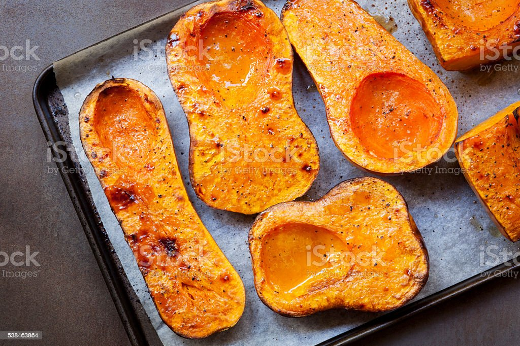 Roasting Butternut Pumpkin for Soup stock photo