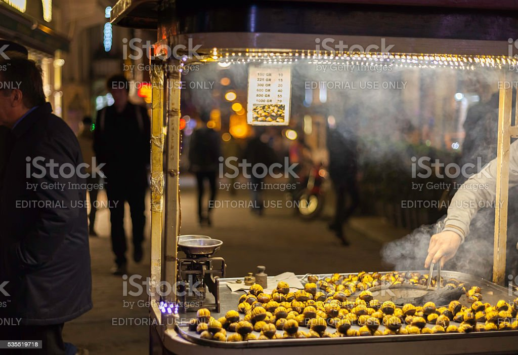 Roasting chestnut seller stock photo