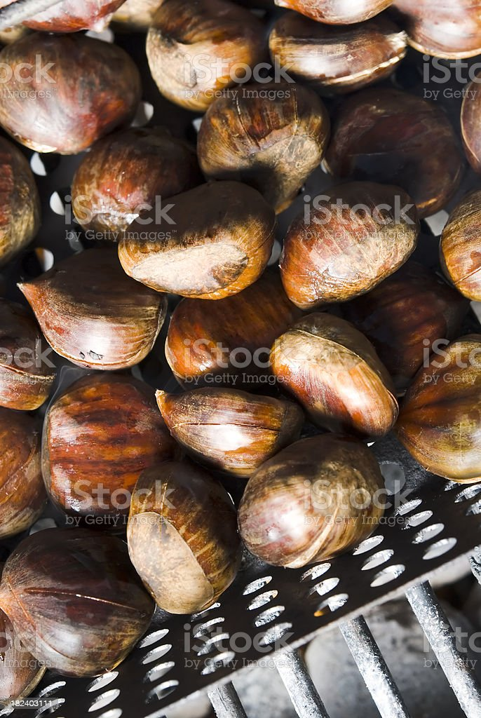Roasting chestnuts on a BBQ - III royalty-free stock photo