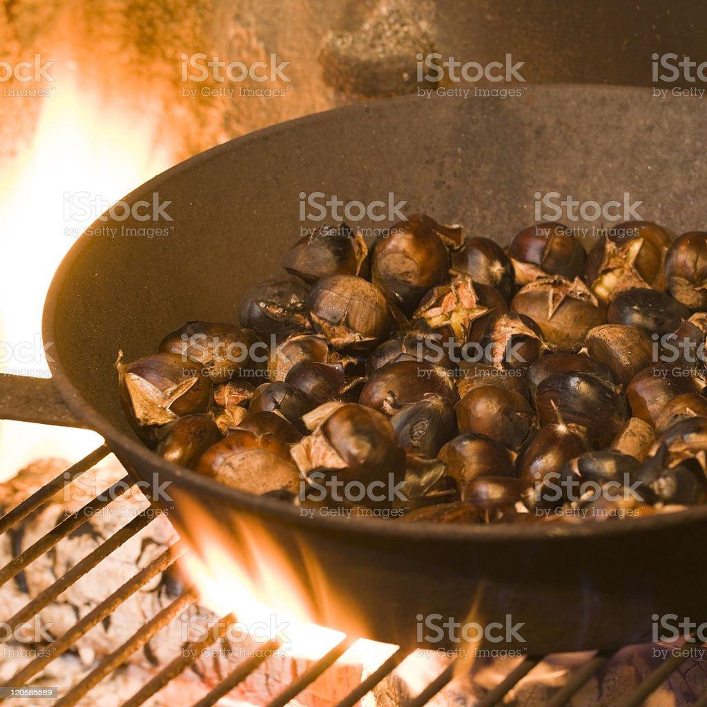 roasting chestnuts stock photo
