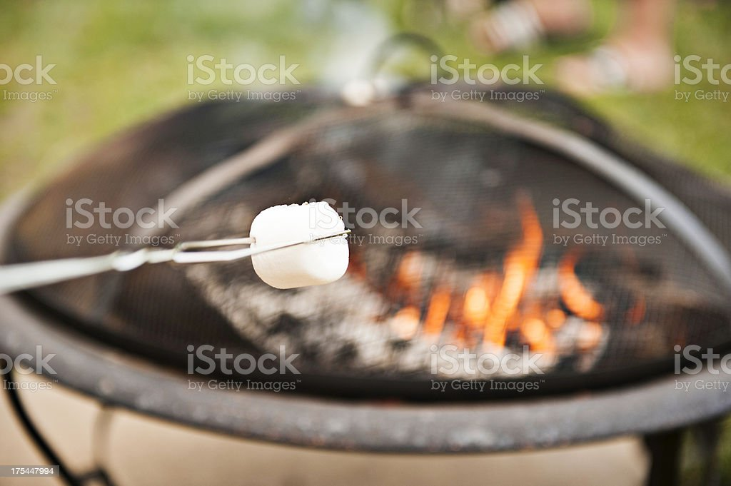 Roasting marshmellows on a fire pit royalty-free stock photo