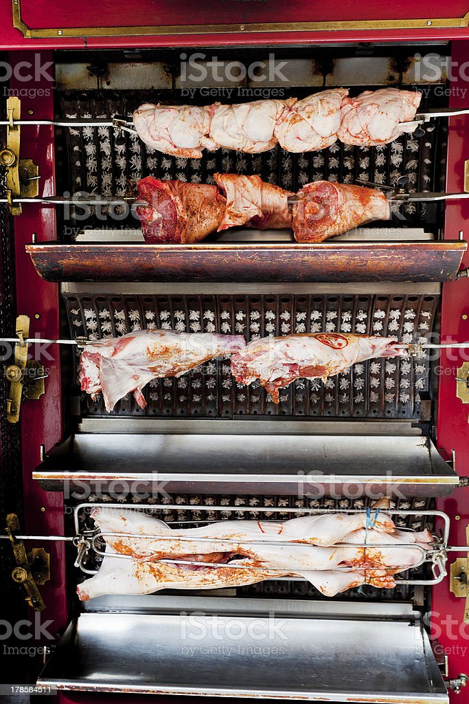 roasting meat on spit royalty-free stock photo
