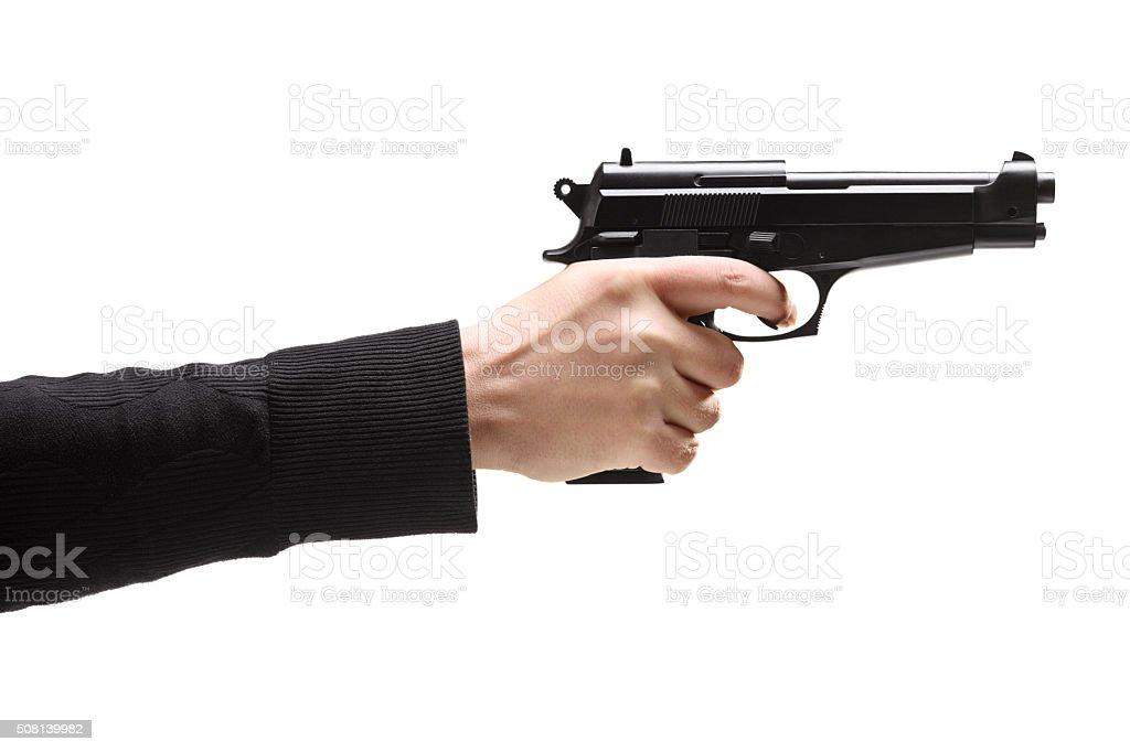 Robber holding a gun stock photo
