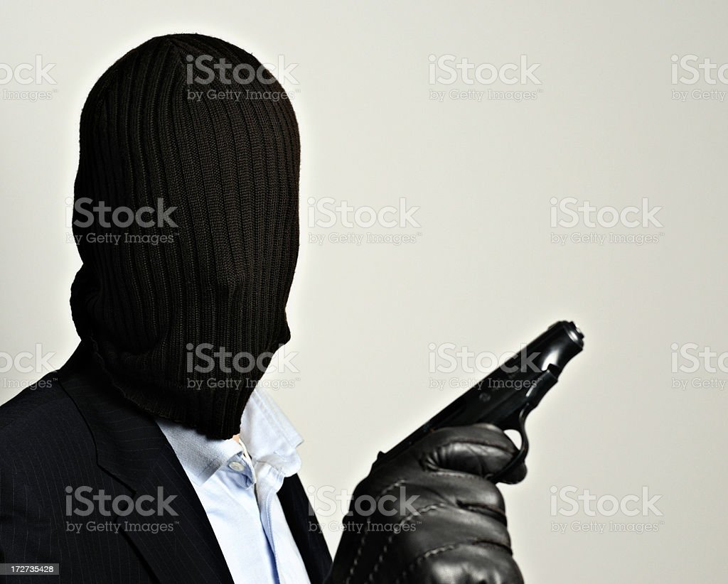robber in disguise stock photo