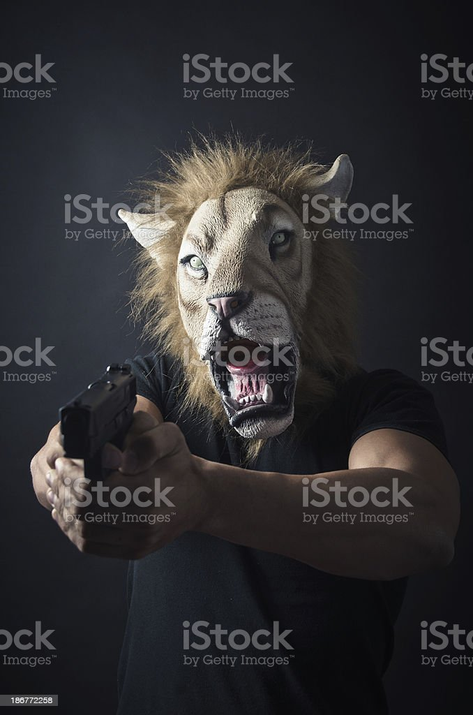 Robber in Lion mask royalty-free stock photo