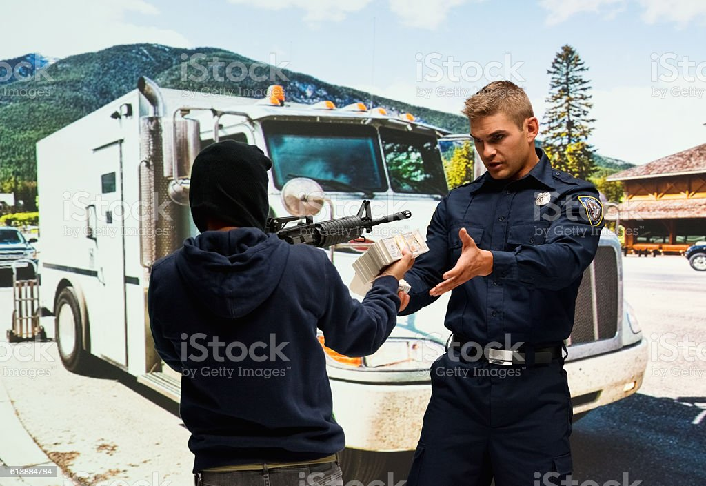 Robber robbing from security guard outdoors stock photo