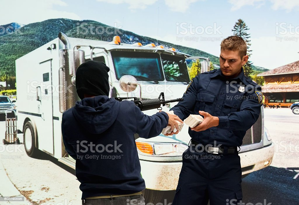 Robber robbing from security guard stock photo