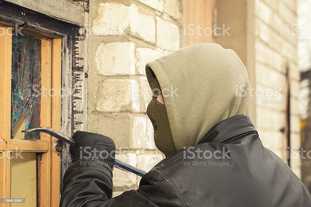 Robber with a crowbar royalty-free stock photo