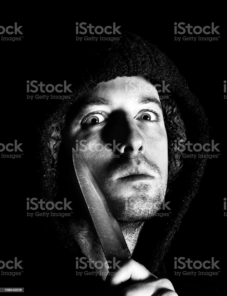 robber with a knife about to mug victim royalty-free stock photo