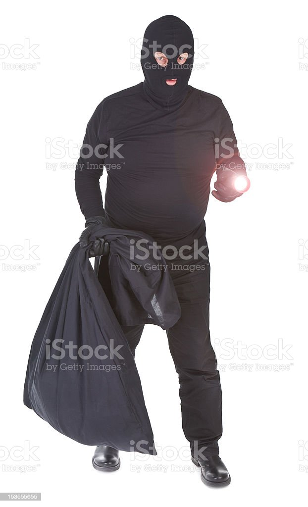 robber with flashlight and sack isolated royalty-free stock photo
