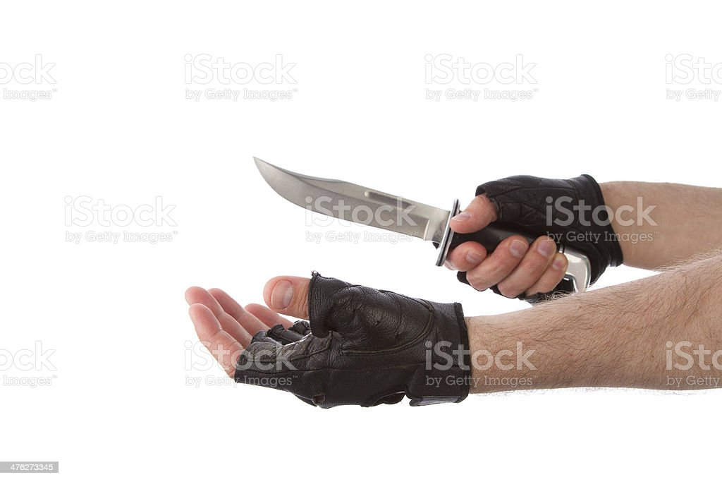 Robber with knife holding out hand royalty-free stock photo