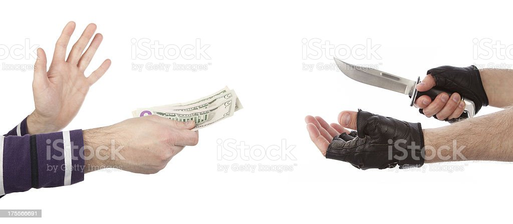 Robber with knife taking money from victim royalty-free stock photo