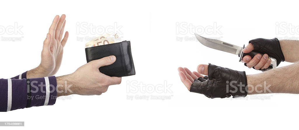 Robber with knife taking wallet from victim royalty-free stock photo