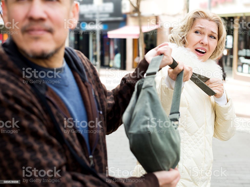 Robbery at day time stock photo