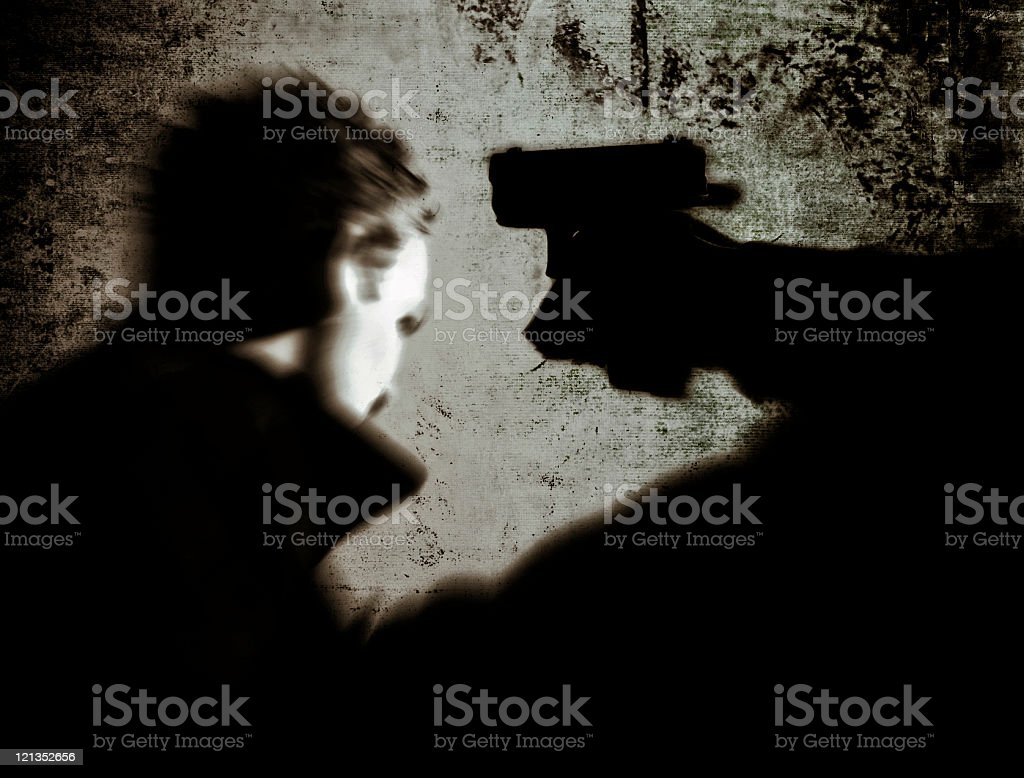 Robbery: Person Pointing Gun at a Man royalty-free stock photo