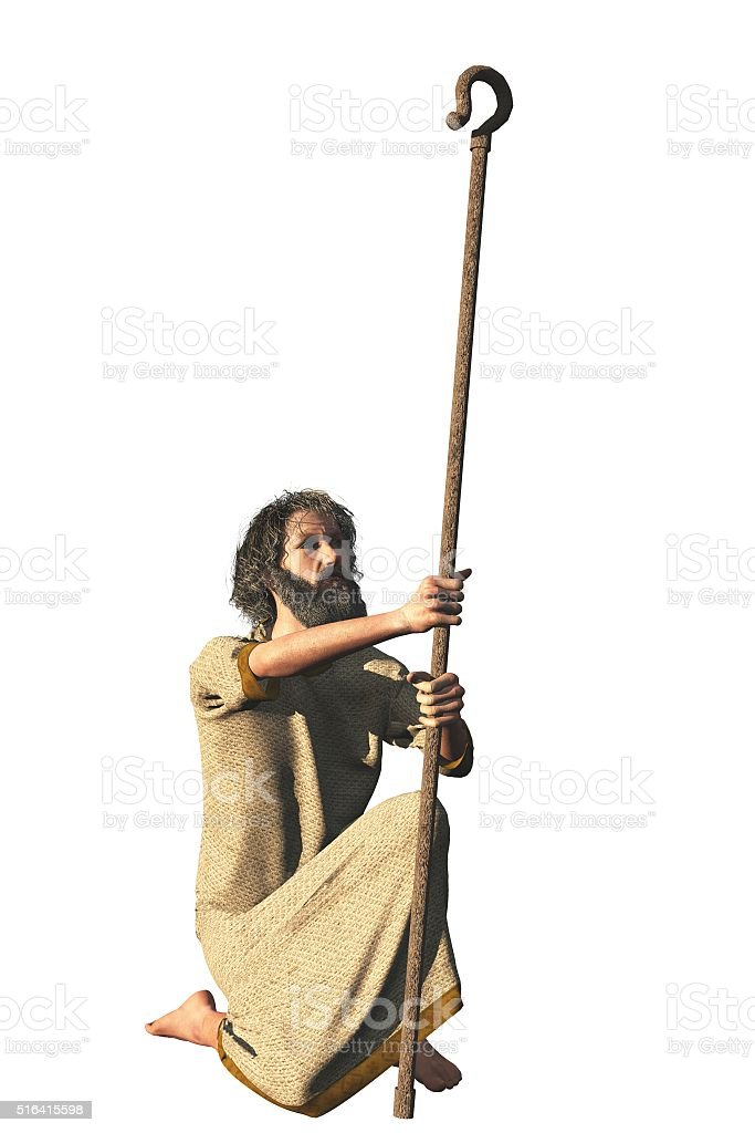 Robed bearded hermit with shepherd crook stock photo