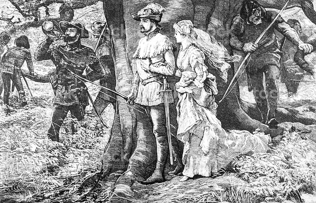 Robin Hood gets married to Maid Marian in forest stock photo