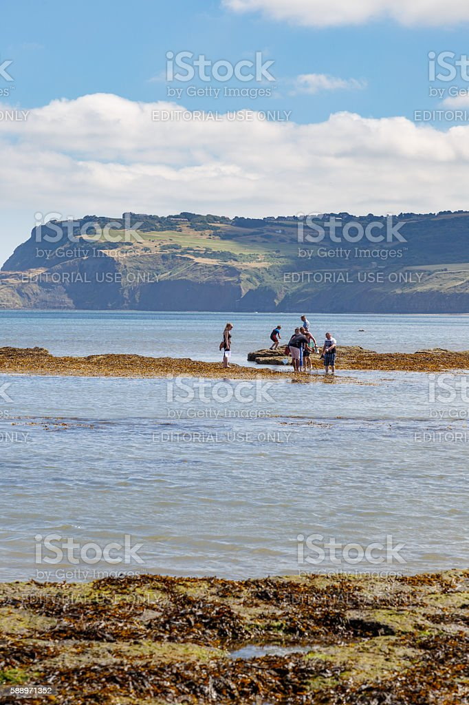 Robin Hoods Bay people fishing and crabbing stock photo