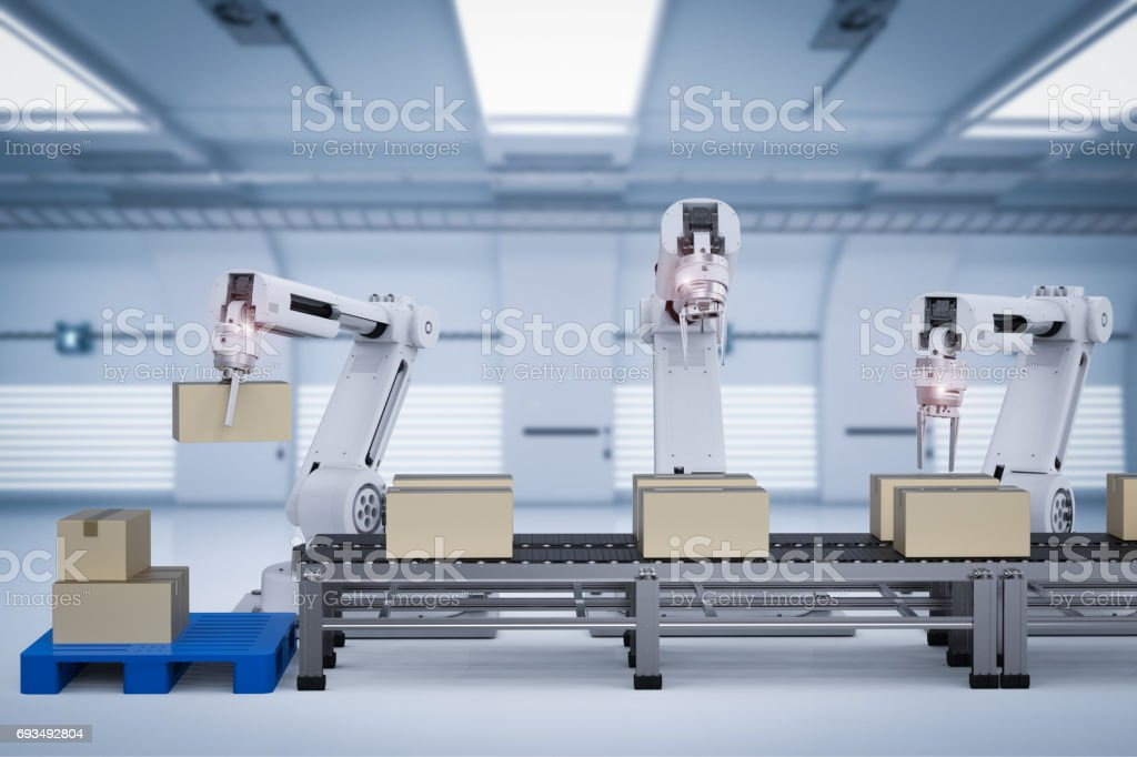 robot arms working with cardboard boxes stock photo