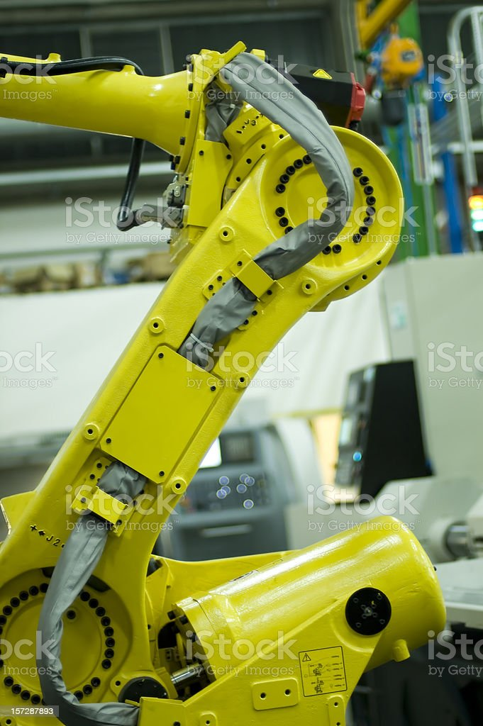Robot at work in line production stock photo