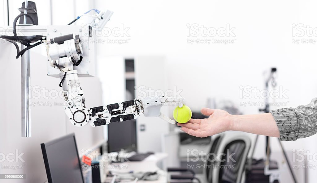 robot hand holds the objects drawn to a man's hand stock photo