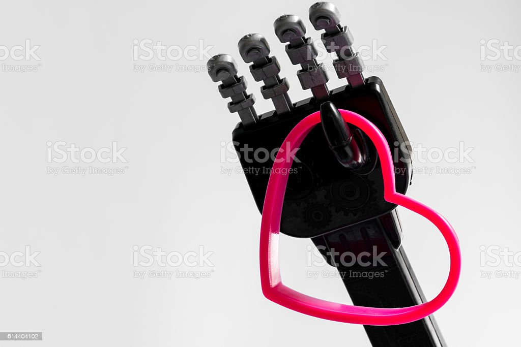 Robot holding a heart stock photo