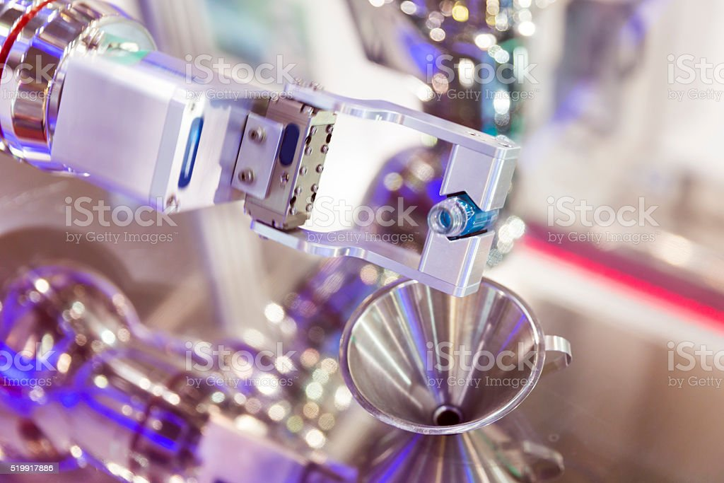 Robot mechanical arm with chemical tubes in a medical laboratory stock photo