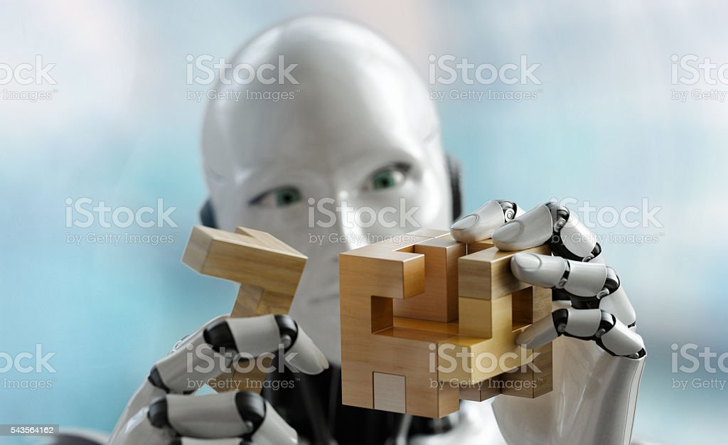 Robot solving a wooden puzzle Close up stock photo