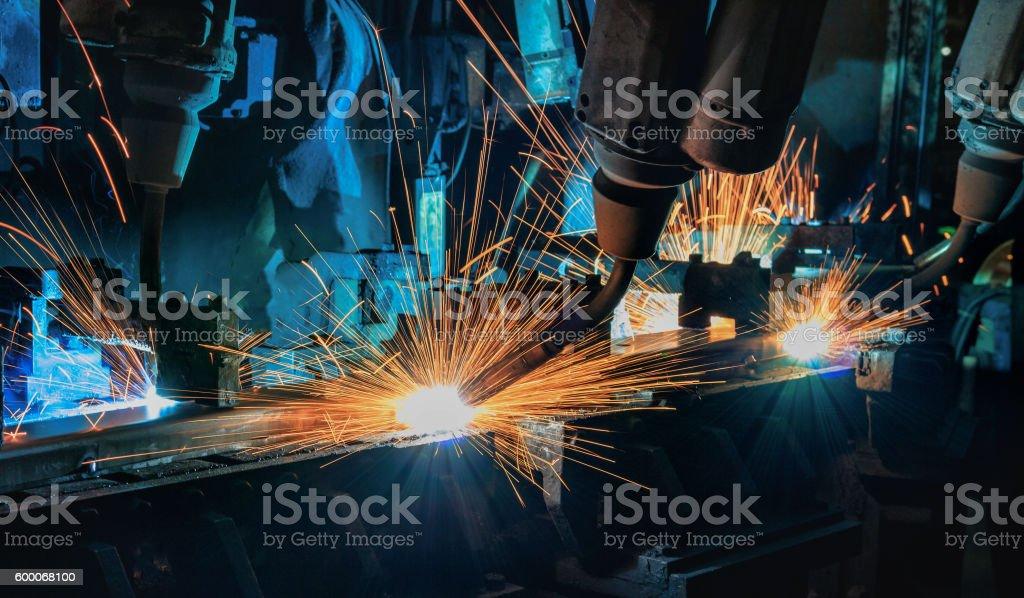 Robot team welding in automotive industry stock photo