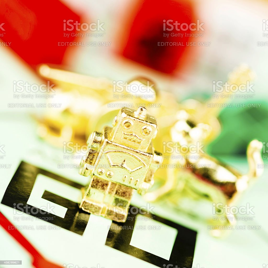 Robot Token on Monopoly Board royalty-free stock photo