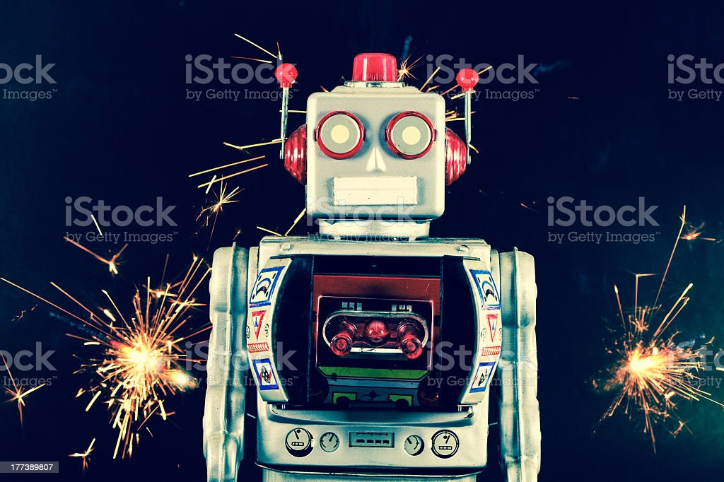 Robot with fireworks on either side stock photo