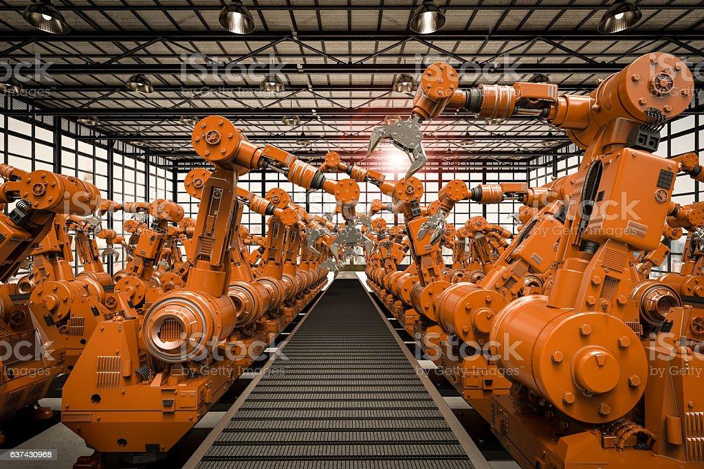 robotic arms with empty conveyor belt stock photo
