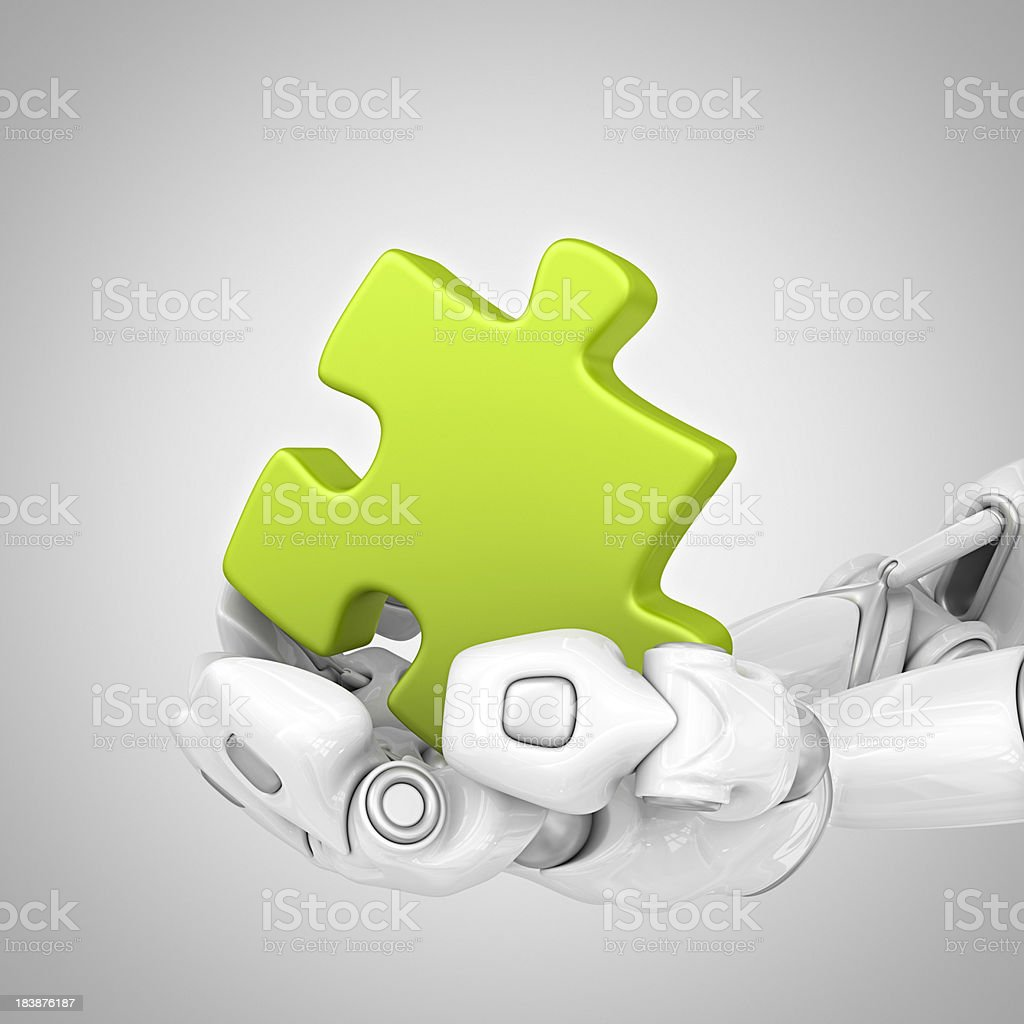 robotic hands holding puzzle royalty-free stock photo