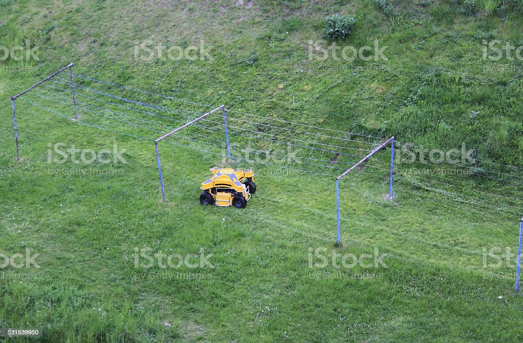 Robotic lawn mower, new technology, remote control stock photo