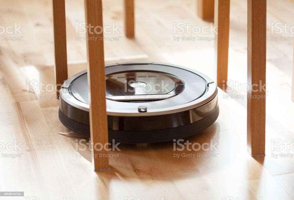Robotic Vacuum Cleaner On Laminate Wood Floor Smart Cleaning