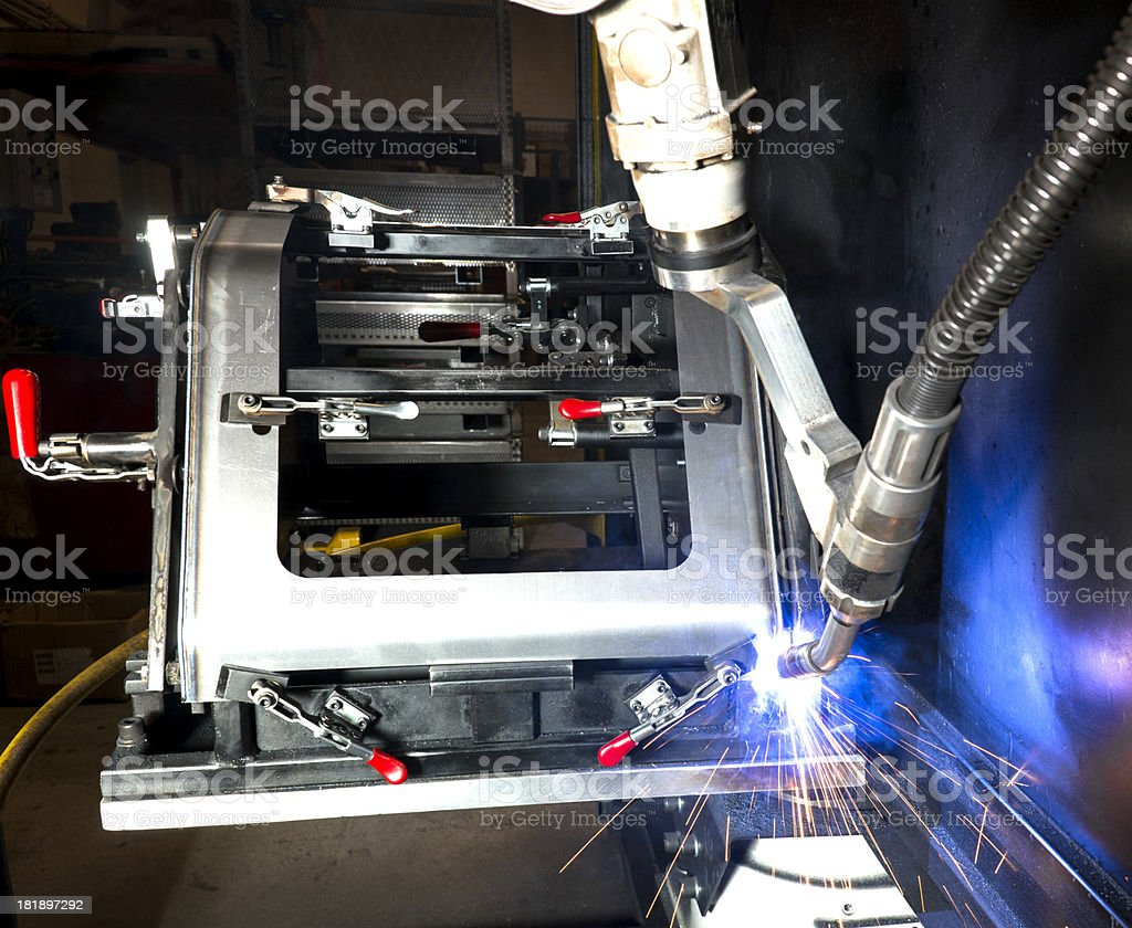 Robotic welding machine in a metal manufacturing plant royalty-free stock photo
