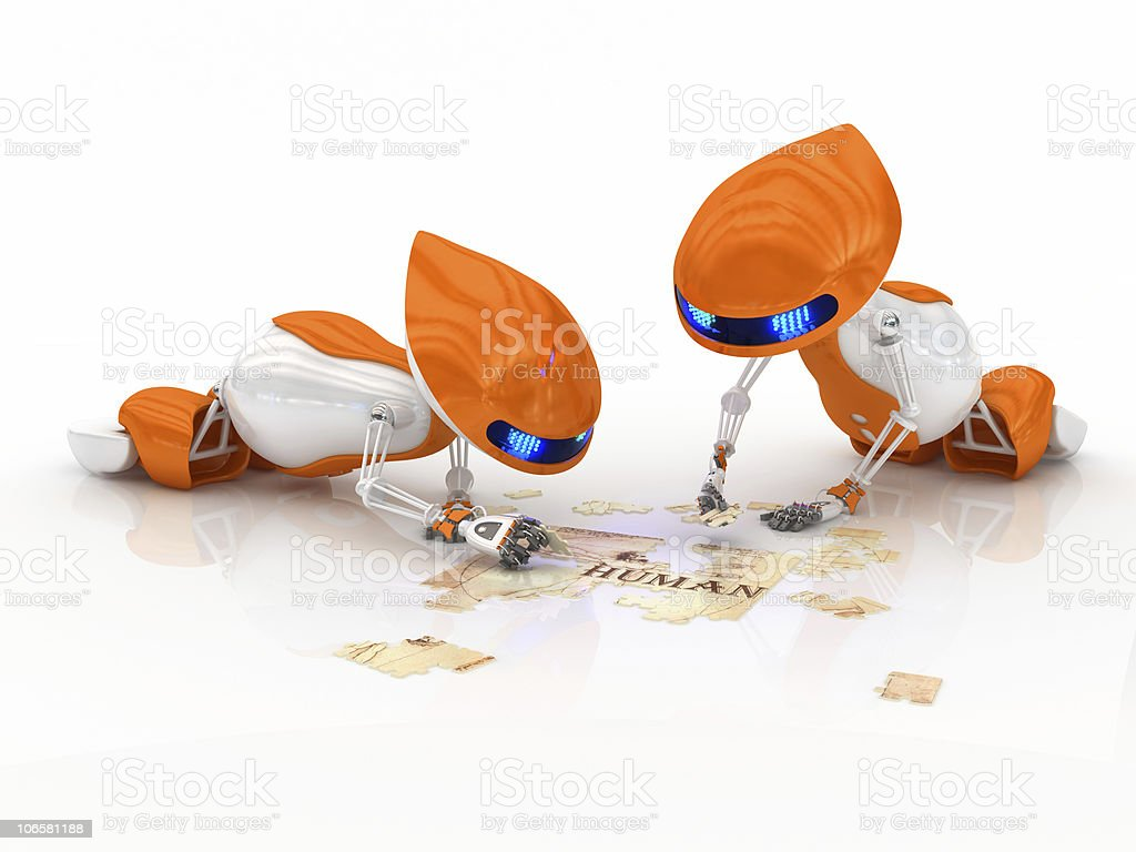 Robots and puzzle stock photo
