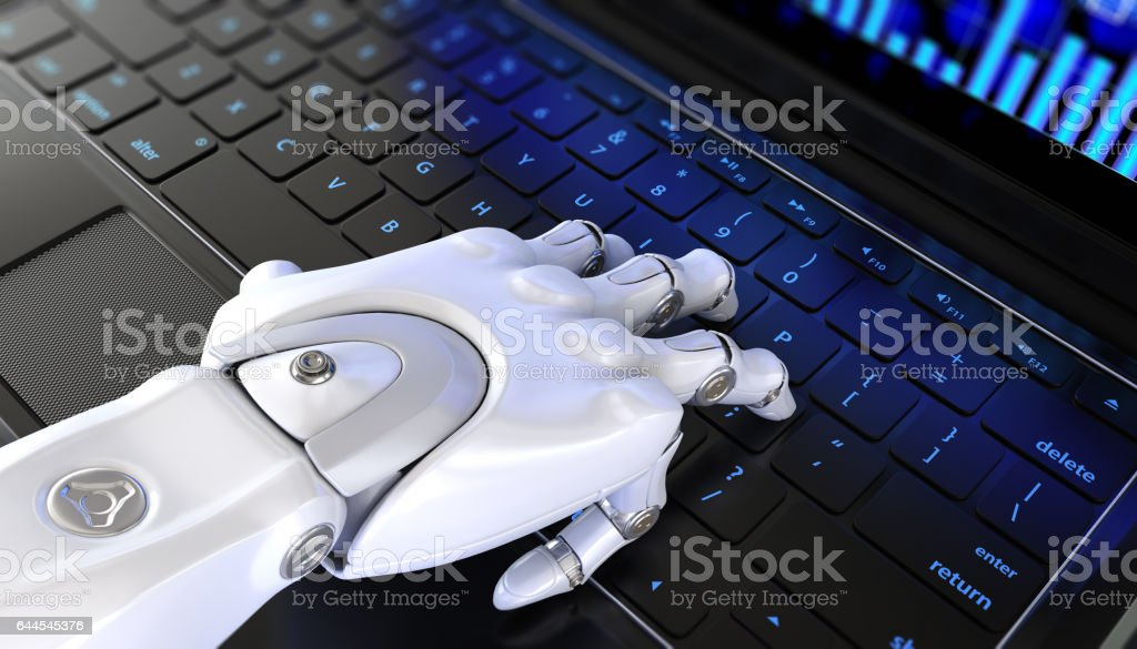 Robot's hand types on keyboard stock photo