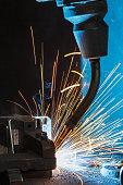 robots welding in a car factory
