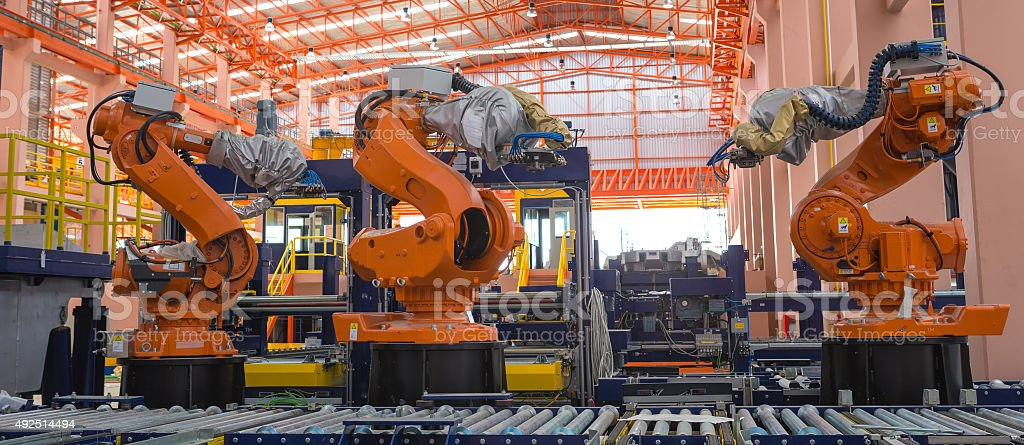 Robots welding in a production line stock photo