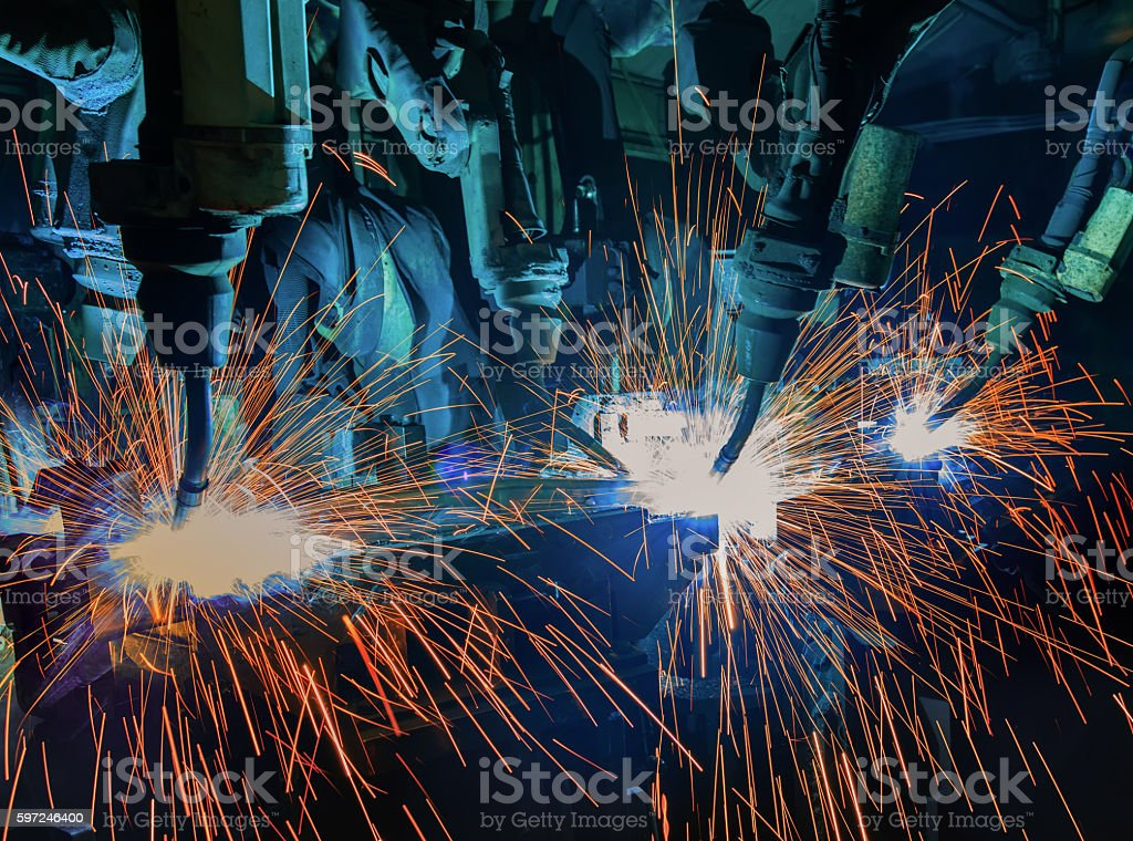 Robots welding in factory stock photo
