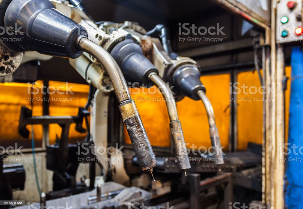 Robots welding team in the automotive parts industry stock photo