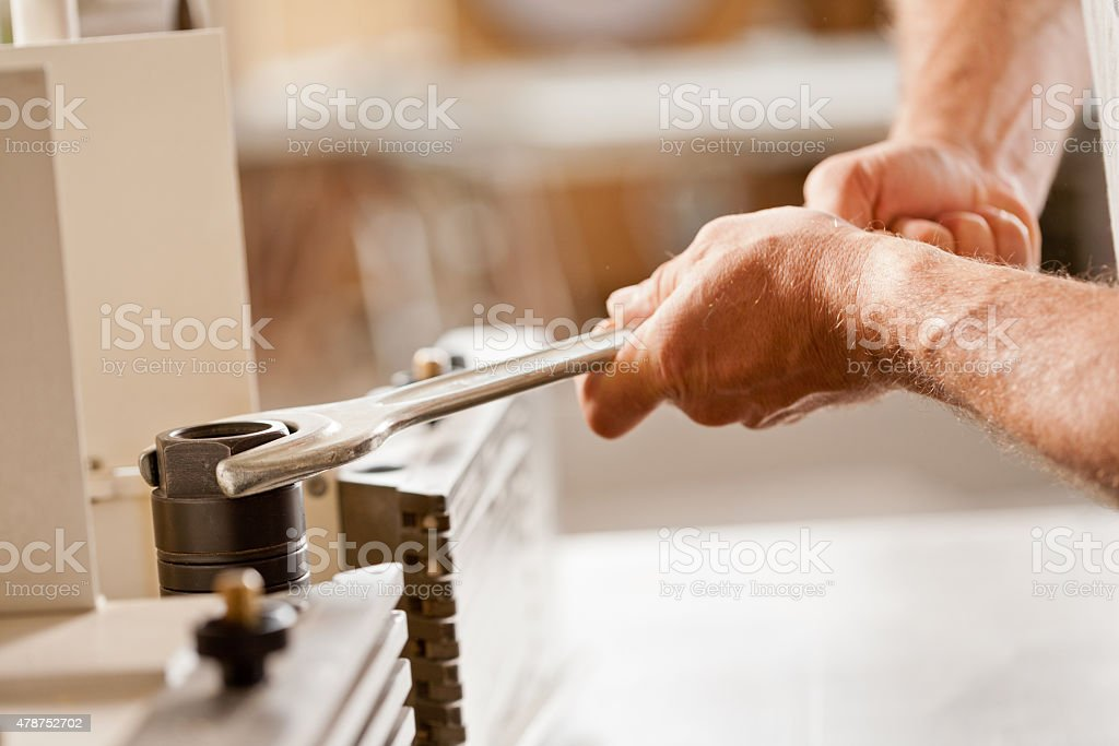 robust hands fastening with a wrench stock photo