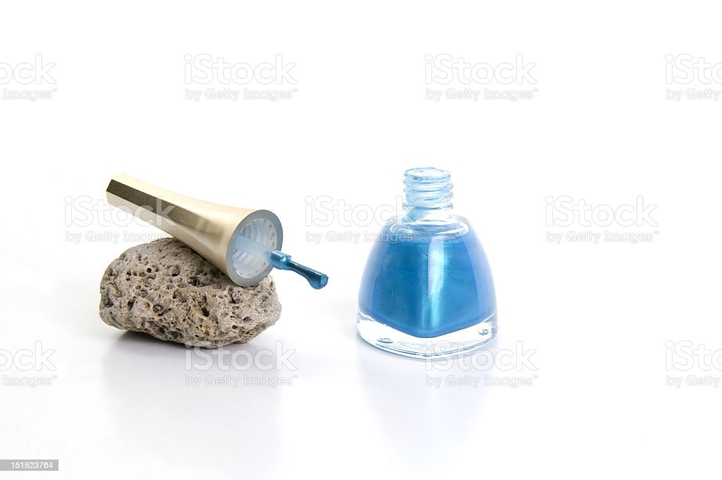 Rock and blue nailpolish royalty-free stock photo