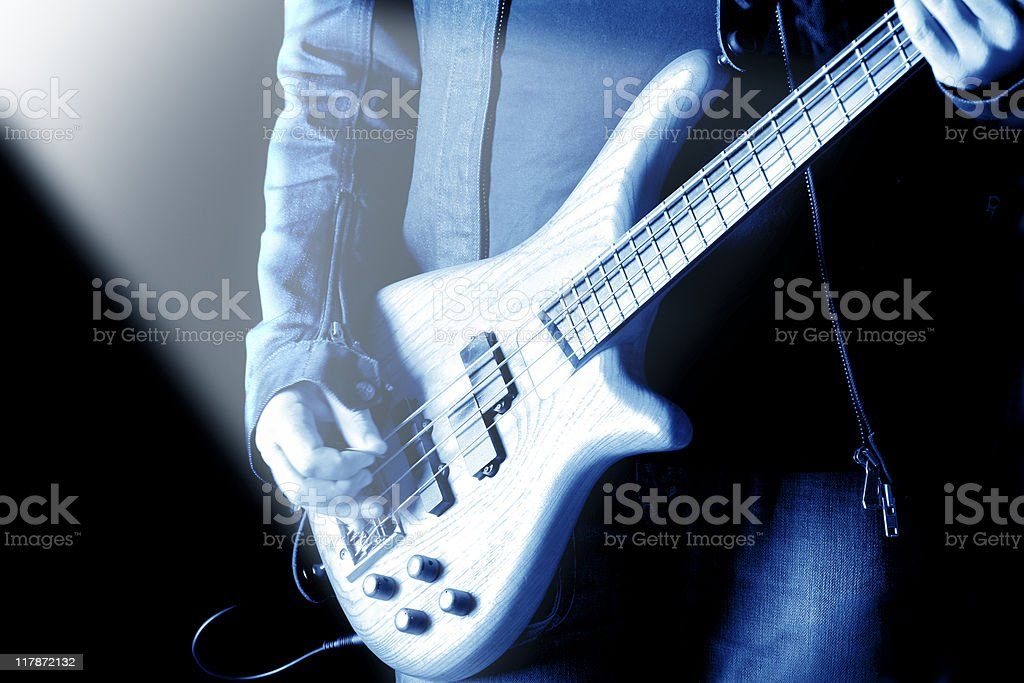 rock and roll guitarist playing stock photo
