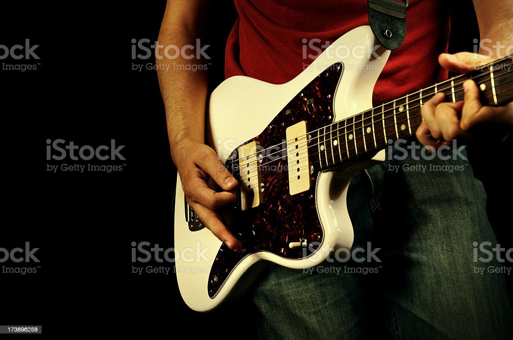 A rock and roll style guitar being played royalty-free stock photo