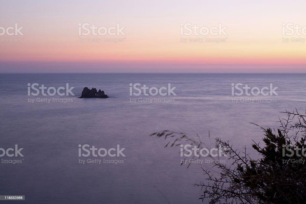 Rock and Sunset on Corfu stock photo