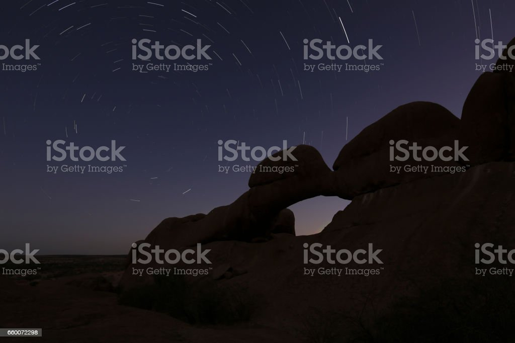 Rock arch at the Spitzkoppe at night stock photo